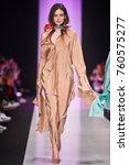 a model walks the runway on the ... | Shutterstock . vector #760575277