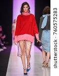 a model walks the runway on the ... | Shutterstock . vector #760575283