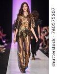 a model walks the runway on the ... | Shutterstock . vector #760575307