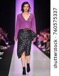 a model walks the runway on the ... | Shutterstock . vector #760575337