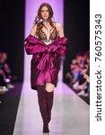 a model walks the runway on the ... | Shutterstock . vector #760575343