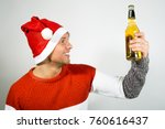 young santa claus with a bottle ... | Shutterstock . vector #760616437