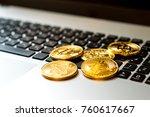 golden bitcoin on keyboard | Shutterstock . vector #760617667