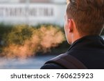 Small photo of exhaling in the morning, cold breath, warm air breathing