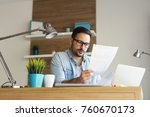 smiling young freelancer... | Shutterstock . vector #760670173
