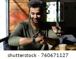 man sitting and puts hand on... | Shutterstock . vector #760671127