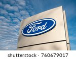 Small photo of Worcester (UK) - November 2017: Ford dealership sign against a blue sky.