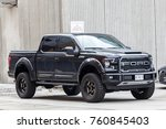 Small photo of Toronto, Canada - Oct 14, 2017: Black Ford F 150 SVT Raptor Dakar Edition on a parking lot in the city of Toronto