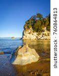 Small photo of Creek and beach at sunset in Abel Tasman National Park. New Zealand