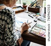 Small photo of Artist drawing with watercolors