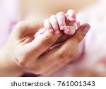 Baby Holding Hands  Mother...