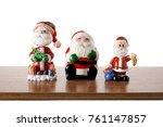santa clause figurines on shelf | Shutterstock . vector #761147857