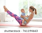 young mother doing yoga with... | Shutterstock . vector #761194663