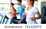 group of friends exercising on... | Shutterstock . vector #761220373