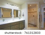 Small photo of Master bathroom Design With Luxury walk-in shower accented with mosaic strip And double bathroom vanity atop beige tiled floor .