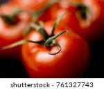 fresh tomatoes closeup | Shutterstock . vector #761327743