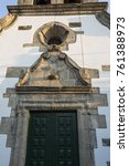 Small photo of Detail of the rosacea and nich above the portal of the Parish Church of Bacal, Braganca, Portugal