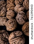 Small photo of Walnuts heap on black background