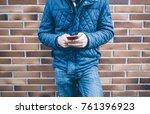 young man using smart phone | Shutterstock . vector #761396923