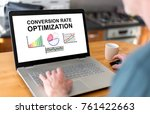 Small photo of Man using a laptop with conversion rate optimization concept on the screen