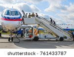 Small photo of The Zhukovsky Airfield, Moscow region, Russia - August 19, 2009: The ladder at the passenger regional aircraft Superjet 100 (Sukhoi Superjet-100). MAKS 2009