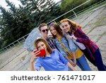 teenagers walking outside | Shutterstock . vector #761471017