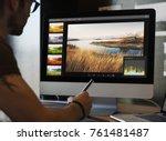 Man editing photos on a computer
