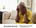 senior woman sitting on sofa at ...   Shutterstock . vector #761611177