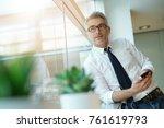 businessman talking on phone... | Shutterstock . vector #761619793