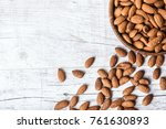 Almonds In Wooden Bowl On Wiht...