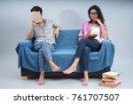 A Couple Sitting On A Sofa  A...