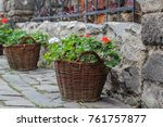 Flowers In Pots Hang On The...