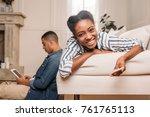 happy african american couple... | Shutterstock . vector #761765113