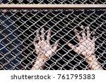 hands of prisoner in jail as... | Shutterstock . vector #761795383