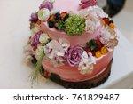 pink wedding cake decorated... | Shutterstock . vector #761829487