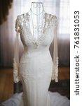 wedding dress hanging on a... | Shutterstock . vector #761831053