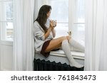 woman is sitting on the... | Shutterstock . vector #761843473