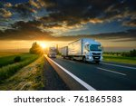 overtaking trucks on an asphalt ... | Shutterstock . vector #761865583