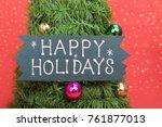 happy holiday written on pine... | Shutterstock . vector #761877013