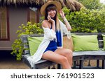cheerful woman in straw hat... | Shutterstock . vector #761901523