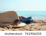 hat with sunglasses and beach... | Shutterstock . vector #761906203
