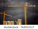 construction cranes and building | Shutterstock . vector #762013117