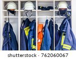 firemen suits and helmets at... | Shutterstock . vector #762060067
