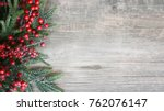 holiday evergreen branches and... | Shutterstock . vector #762076147