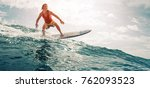 surfer rides the ocean wave.... | Shutterstock . vector #762093523