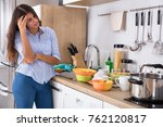 tired young woman standing near ... | Shutterstock . vector #762120817