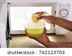 human hand putting sliced lemon ...   Shutterstock . vector #762123703