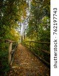 footbridge in park in autumn... | Shutterstock . vector #762197743