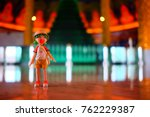 Small photo of BANGKOK, THAILAND - NOVEMBER 23, 2017: Miniature Yotsuba Koiwai anime figure traveling at Wat Paknam Temple, Bangkok. Yotsuba Koiwai is famous Japanese comedy maga series.