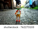 Small photo of BANGKOK, THAILAND - NOVEMBER 23, 2017: Miniature Yotsuba Koiwai anime figure standing on the road. It's famous Japanese comedy maga series.